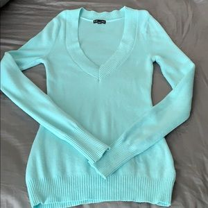 Teal sweater with a deep v-neck